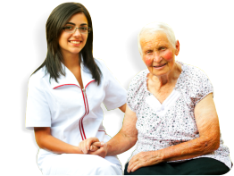 caregiver holding the hands of an elderly patient