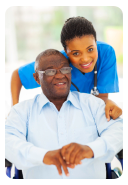 caregiver leaning towards elderly patient